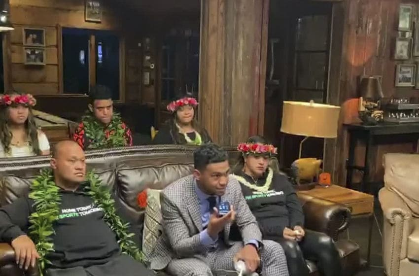 UNSPECIFIED LOCATION - APRIL 23: (EDITORIAL USE ONLY) In this still image from video provided by the NFL, Tua Tagovailoa, front center, holds up a phone during the first round of the 2020 NFL Draft on April 23, 2020. (Photo by NFL via Getty Images)