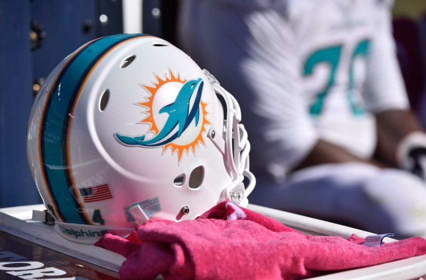 NASHVILLE, TN - OCTOBER 18: A helment of the Miami Dolphins rests on the sideline during a game against the Tennessee Titans at Nissan Stadium on October 18, 2015 in Nashville, Tennessee. (Photo by Frederick Breedon/Getty Images)