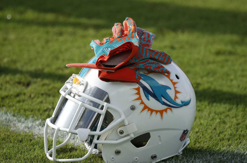 DAVIE, FL - AUGUST 15: A Miami Dolphins helmet and pair of gloves sits on the field during the teams training camp on August 15, 2016 at the Miami Dolphins training facility in Davie, Florida. (Photo by Joel Auerbach/Getty Images)