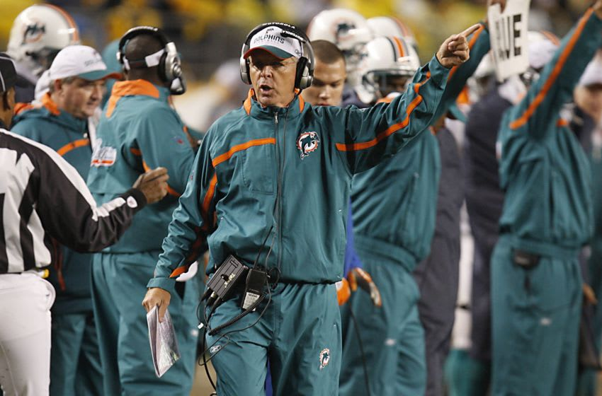 PITTSBURGH - NOVEMBER 26: Head coach Cam Cameron of the Miami Dolphins points during the NFL game against the Pittsburgh Steelers at Heinz Field on November 26, 2007 in Pittsburgh, Pennsylvania. (Photo by Gregory Shamus/Getty Images)