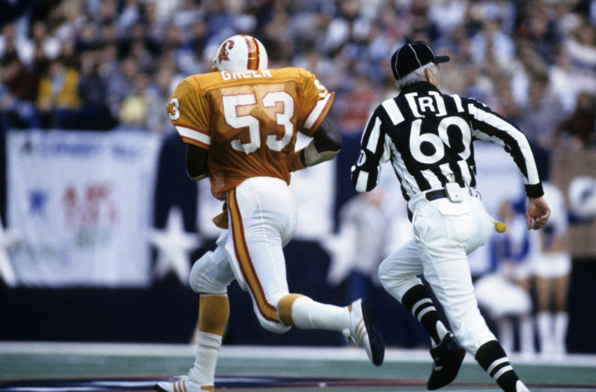 Tampa Bay Buccaneers linebacker Hugh Green's (53) runs with Cowboys quarterback Danny White's fumble for a 60-yard touchdown return during the Buccaneers 30-17 loss to the Dallas Cowboys in the 1982 NFC First-Round Playoff Game in January 9, 1983 at Texas Stadium in Irving, Texas. (Photo by Sylvia Allen/Getty Images) *** Local Caption ***