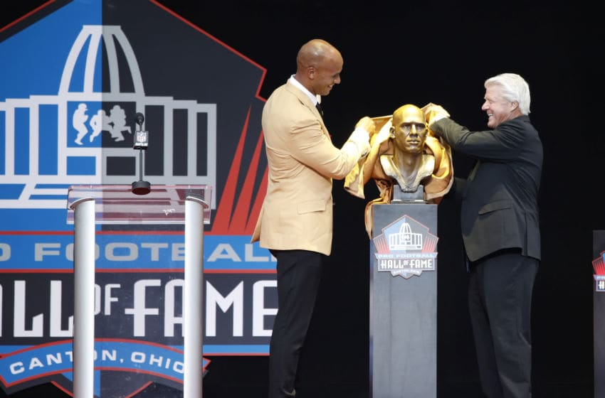 CANTON, OH - AUGUST 05: Jason Taylor and presenter Jimmie Johnson unveil Taylor's bust during the Pro Football Hall of Fame Enshrinement Ceremony at Tom Benson Hall of Fame Stadium on August 5, 2017 in Canton, Ohio. (Photo by Joe Robbins/Getty Images)