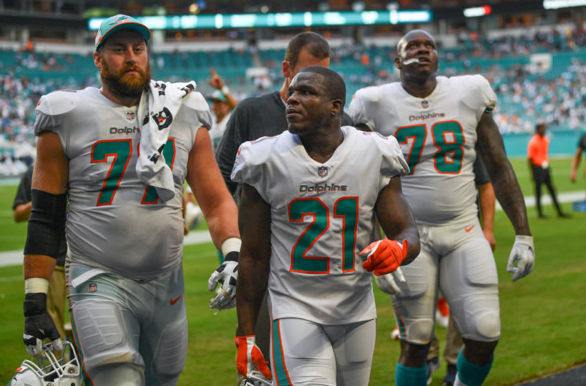 MIAMI, FL - SEPTEMBER 09: (L-R) Jesse Davis #77, Frank Gore #21, and Laremy Tunsil #78 of the Miami Dolphins head to the locker room during a lightning delay in the third quarter against the Tennessee Titans at Hard Rock Stadium on September 9, 2018 in Miami, Florida. (Photo by Mark Brown/Getty Images)
