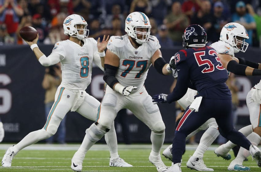 HOUSTON, TX - OCTOBER 25: Brock Osweiler #8 of the Miami Dolphins looks to pass as Jesse Davis #77 blocks Duke Ejiofor #53 of the Houston Texans in the second quarter at NRG Stadium on October 25, 2018 in Houston, Texas. (Photo by Tim Warner/Getty Images)