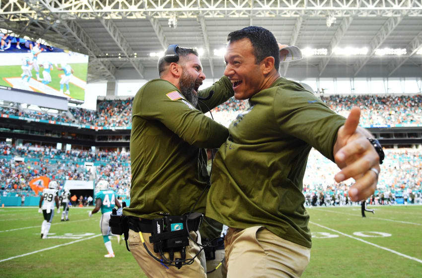 MIAMI, FL - NOVEMBER 04: Defensive Coordinator Matt Burke and Head Strength and Conditioning Coach Dave Puloka of the Miami Dolphins celebrates a touchdown in the fourth quarter of their game against the New York Jets at Hard Rock Stadium on November 4, 2018 in Miami, Florida. (Photo by Mark Brown/Getty Images)