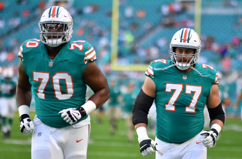 MIAMI, FL - DECEMBER 23: Ja'Wuan James #70 and Jesse Davis #77 of the Miami Dolphins in action against the Jacksonville Jaguars at Hard Rock Stadium on December 23, 2018 in Miami, Florida. (Photo by Mark Brown/Getty Images)