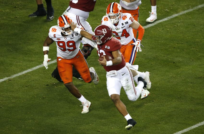 SANTA CLARA, CALIFORNIA - JANUARY 07: Clelin Ferrell #99 of the Clemson Tigers tackles Tua Tagovailoa #13 of the Alabama Crimson Tide on fourth down during the fourth quarter in the College Football Playoff National Championship at Levi's Stadium on January 07, 2019 in Santa Clara, California. (Photo by Lachlan Cunningham/Getty Images)