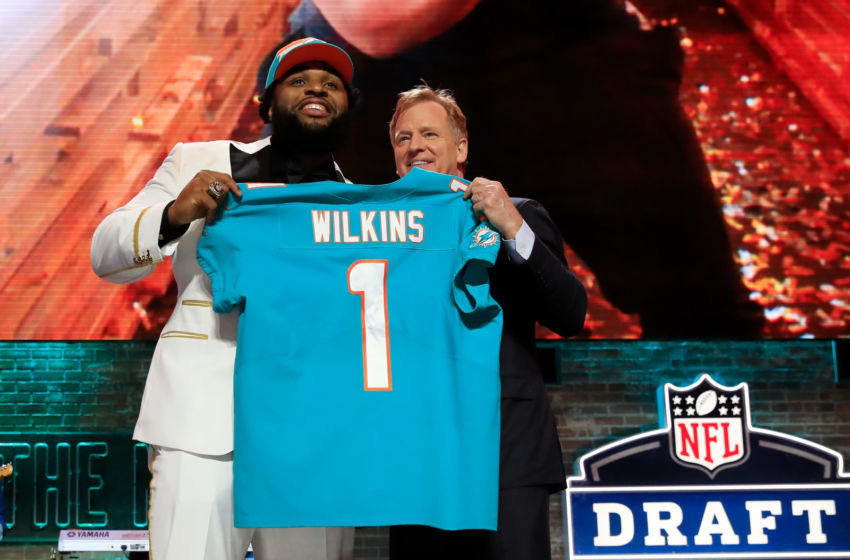 NASHVILLE, TENNESSEE - APRIL 25: Christian Wilkins of Clemson poses with NFL Commissioner Roger Goodell after being chosen #13 overall by the Miami Dolphins during the first round of the 2019 NFL Draft on April 25, 2019 in Nashville, Tennessee. (Photo by Andy Lyons/Getty Images)