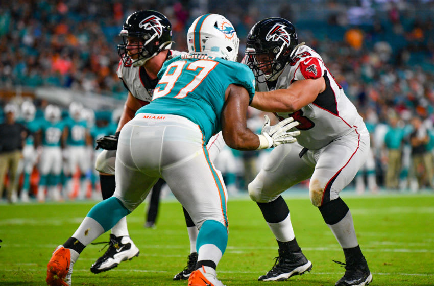 MIAMI, FL - AUGUST 08: Chris Lindstrom #63 of the Atlanta Falcons defends against Christian Wilkins #97 of the Miami Dolphins in the first quarter during a preseason game at Hard Rock Stadium on August 8, 2019 in Miami, Florida. (Photo by Mark Brown/Getty Images)