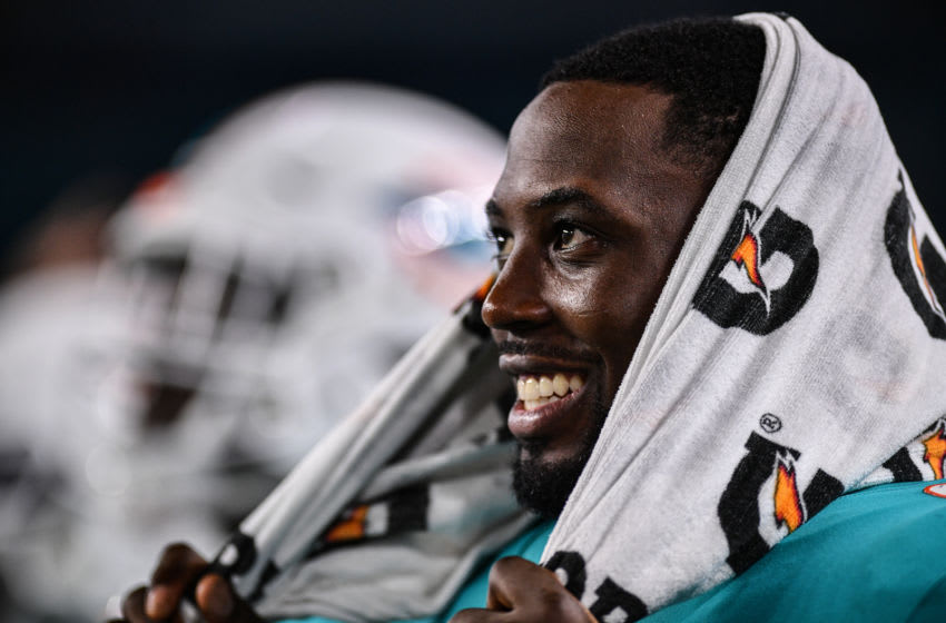 MIAMI, FL - AUGUST 08: Charles Harris #90 of the Miami Dolphins reacts to the Dolphins scoring a touchdown in the fourth quarter during a preseason game against the Atlanta Falcons at Hard Rock Stadium on August 8, 2019 in Miami, Florida. (Photo by Mark Brown/Getty Images)