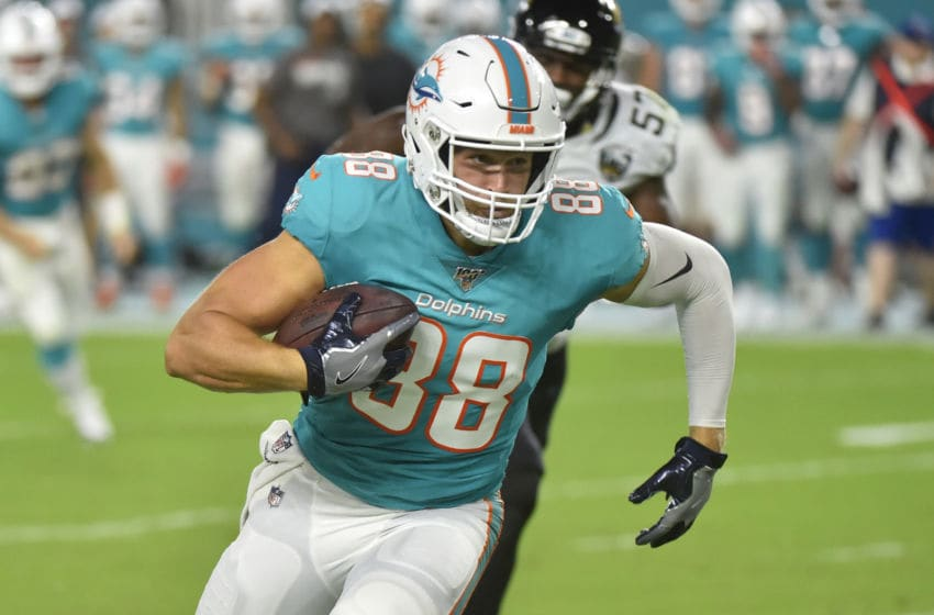 MIAMI, FL - AUGUST 22: Mike Gesicki #88 of the Miami Dolphins runs upfield after making a catch during the second quarter of the preseason game against the Jacksonville Jaguars at Hard Rock Stadium on August 22, 2019 in Miami, Florida. (Photo by Eric Espada/Getty Images)