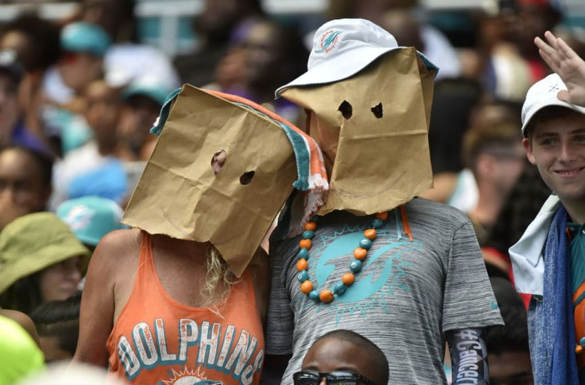 MIAMI, FL - SEPTEMBER 08: A pair of Miami Dolphins fans wear bags on their heads during the first half of the game against the Baltimore Ravens at Hard Rock Stadium on September 8, 2019 in Miami, Florida. (Photo by Eric Espada/Getty Images)
