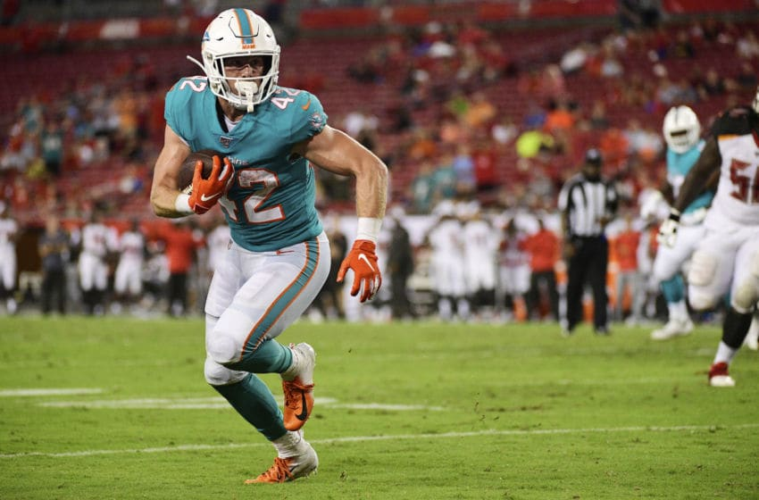 TAMPA, FLORIDA - AUGUST 16: Patrick Laird #42 of the Miami Dolphins catches an 8-yard touchdown pass thrown by Jake Rudock #5 in the fourth quarter of a preseason football game against the Tampa Bay Buccaneers at Raymond James Stadium on August 16, 2019 in Tampa, Florida. (Photo by Julio Aguilar/Getty Images)