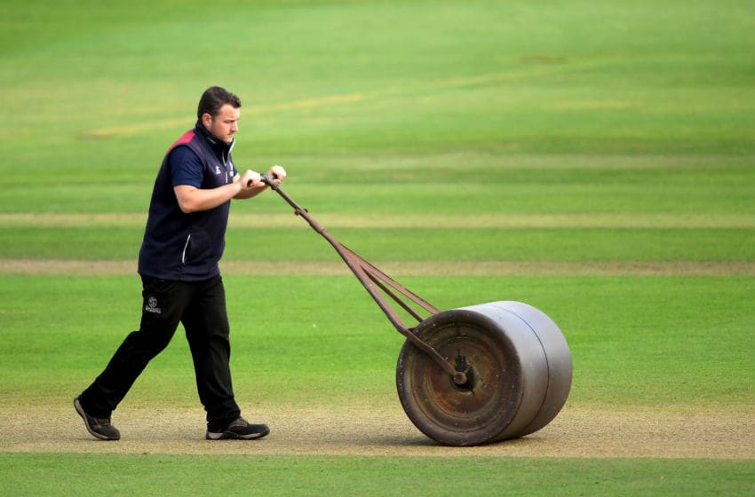 TAUNTON, ENGLAND - SEPTEMBER 24: A member of the Somerset ground staff rolls the pitch during Day Two of the Specsavers County Championship Division One match between Somerset and Essex at The Cooper Associates County Ground on September 24, 2019 in Taunton, England. (Photo by Alex Davidson/Getty Images)