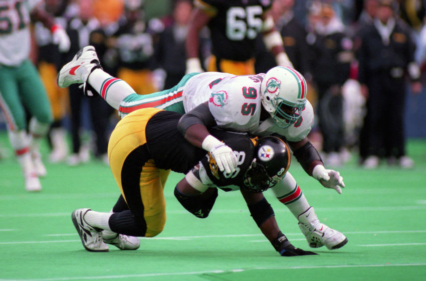 PITTSBURGH, PA - NOVEMBER 20: Defensive lineman Tim Bowens #95 of the Miami Dolphins tackles tight end Eric Green #86 of the Pittsburgh Steelers during a game at Three Rivers Stadium on November 20, 1994 in Pittsburgh, Pennsylvania. The Steelers defeated the Dolphins 16-13. (Photo by George Gojkovich/Getty Images)