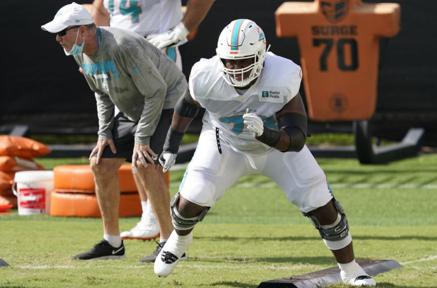 DAVIE, FLORIDA - AUGUST 21: Austin Jackson #73 of the Miami Dolphins performs lineman drills during training camp at Baptist Health Training Facility at Nova Southern University on August 21, 2020 in Davie, Florida. (Photo by Mark Brown/Getty Images)