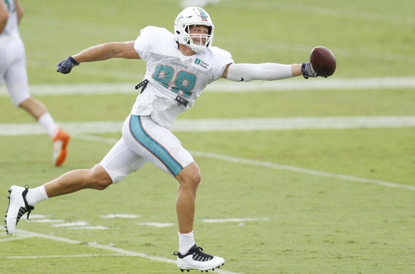 DAVIE, FLORIDA - AUGUST 24: Mike Gesicki #88 of the Miami Dolphins reaches for a pass during training camp at Baptist Health Training Facility at Nova Southern University on August 24, 2020 in Davie, Florida. (Photo by Michael Reaves/Getty Images)