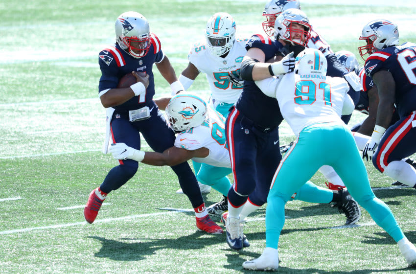 FOXBOROUGH, MASSACHUSETTS - SEPTEMBER 13: Christian Wilkins #94 of the Miami Dolphins attempts to sack Cam Newton #1 of the New England Patriots during the first half at Gillette Stadium on September 13, 2020 in Foxborough, Massachusetts. (Photo by Maddie Meyer/Getty Images)