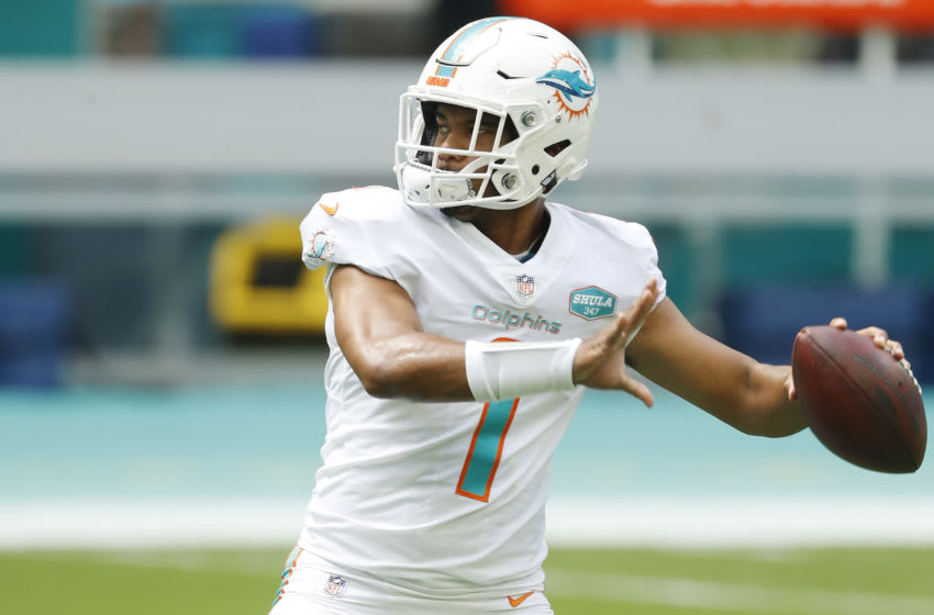 MIAMI GARDENS, FLORIDA - SEPTEMBER 20: Tua Tagovailoa #1 of the Miami Dolphins warms up prior to the game against the Buffalo Bills at Hard Rock Stadium on September 20, 2020 in Miami Gardens, Florida. (Photo by Michael Reaves/Getty Images)