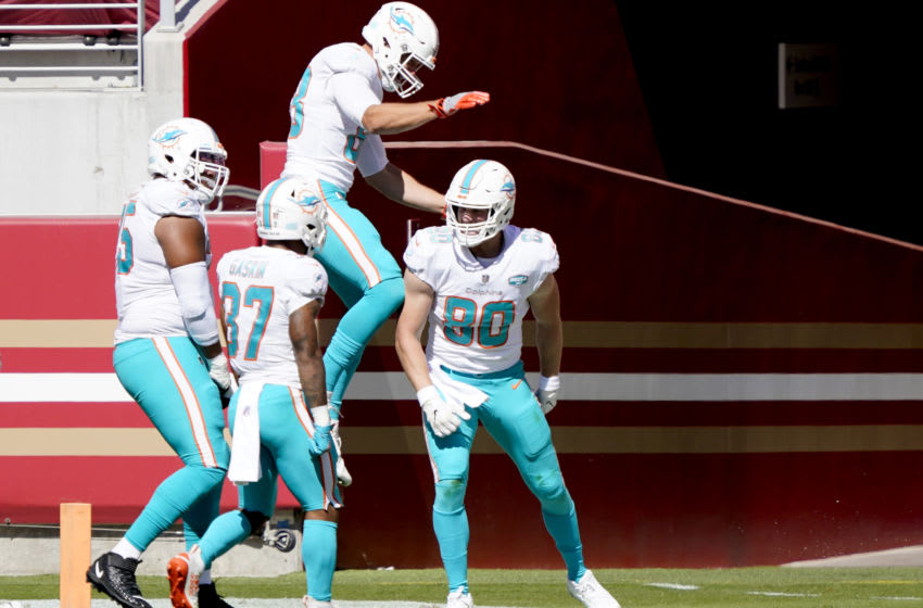 SANTA CLARA, CALIFORNIA - OCTOBER 11: Adam Shaheen #80 of the Miami Dolphins celebrates with teammates after he scored a touchdown against the San Francisco 49ers during the first half of their NFL football game at Levi's Stadium on October 11, 2020 in Santa Clara, California. (Photo by Thearon W. Henderson/Getty Images)