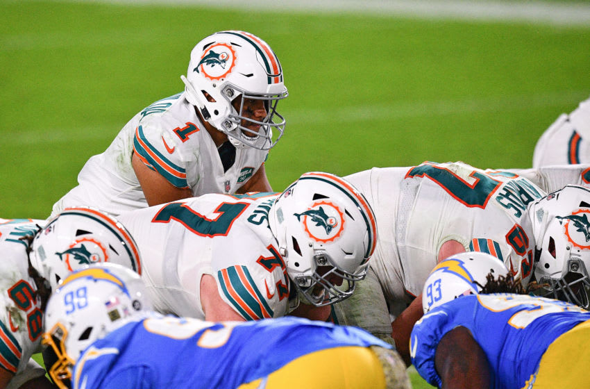 MIAMI GARDENS, FLORIDA - NOVEMBER 15: Tua Tagovailoa #1 of the Miami Dolphins prepares to snap the ball against the Los Angeles Chargers during the second half at Hard Rock Stadium on November 15, 2020 in Miami Gardens, Florida. (Photo by Mark Brown/Getty Images)