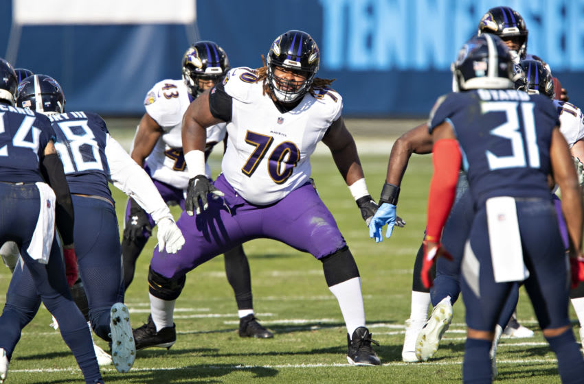 NASHVILLE, TENNESSEE - JANUARY 10: Guard D.J. Fluker #70 of the Baltimore Ravens drops back to block during their AFC Wild Card Playoff game against the Tennessee Titans at Nissan Stadium on January 10, 2021 in Nashville, Tennessee. The Ravens defeated the Titans 20-13. (Photo by Wesley Hitt/Getty Images)