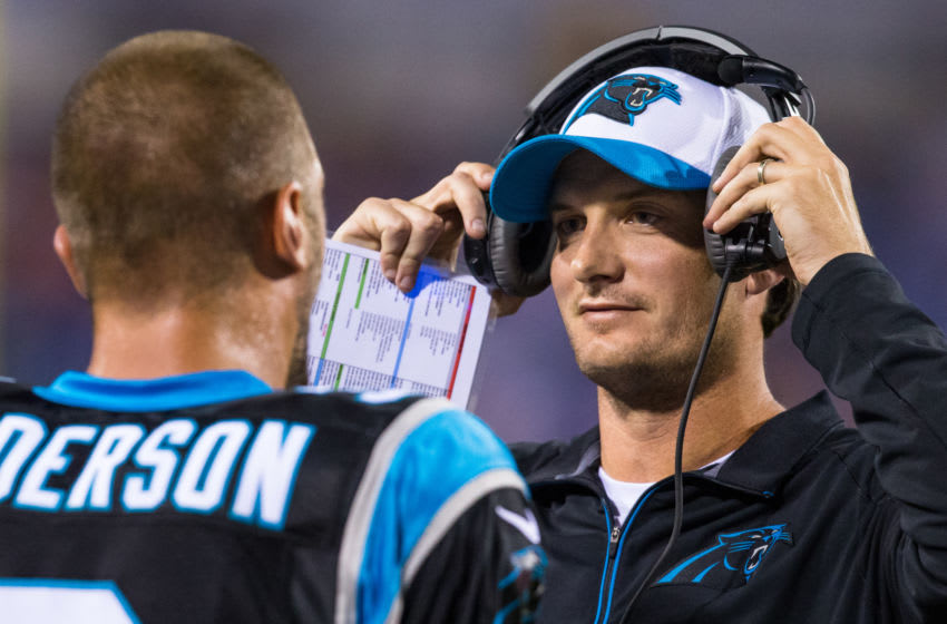 ORCHARD PARK, NY - AUGUST 14: Derek Anderson #3 of the Carolina Panthers speaks with quarterback coach Ken Dorsey during the second half against the Buffalo Bills on August 14, 2015 during a preseason game at Ralph Wilson Stadium in Orchard Park, New York. Carolina defeats Buffalo 25-24. (Photo by Brett Carlsen/Getty Images)