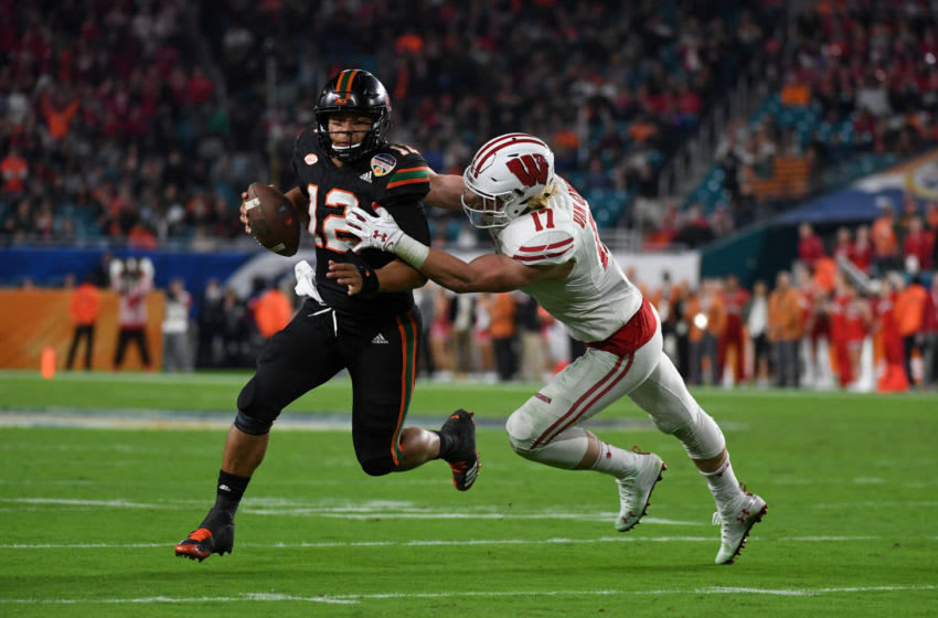 MIAMI GARDENS, FL - DECEMBER 30: Malik Rosier #12 of the Miami Hurricanes is stopped by Andrew Van Ginkel #17 of the Wisconsin Badgers during the fourth quarter of the 2017 Capital One Orange Bowl at Hard Rock Stadium on December 30, 2017 in Miami Gardens, Florida. (Photo by Rob Foldy/Getty Images)