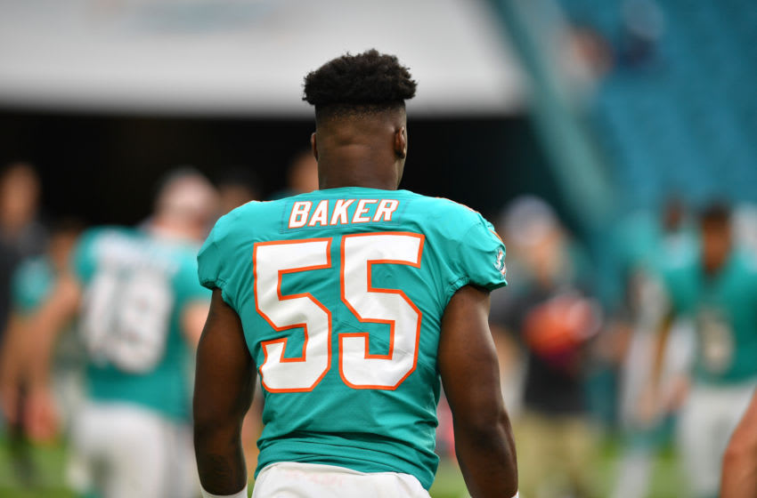 MIAMI, FL - AUGUST 09: Jerome Baker #55 of the Miami Dolphins warms up before a preseason game against the Tampa Bay Buccaneers at Hard Rock Stadium on August 9, 2018 in Miami, Florida. (Photo by Mark Brown/Getty Images)