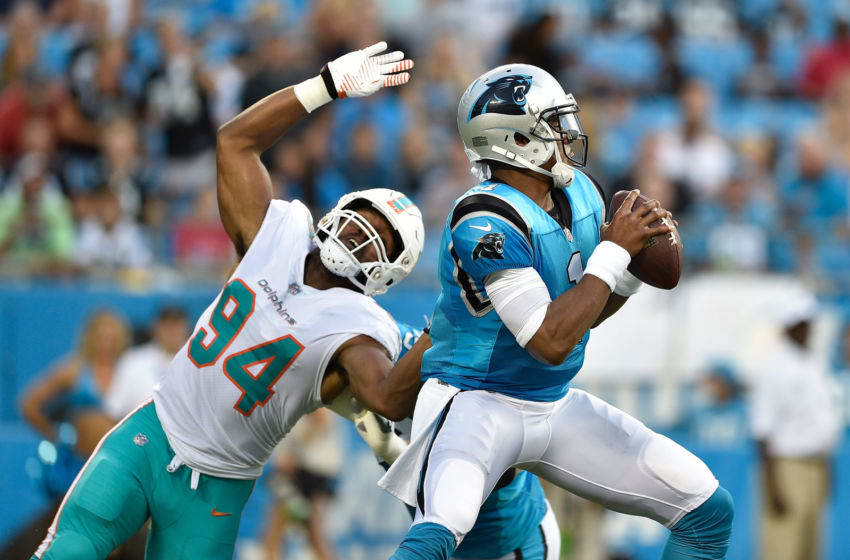 CHARLOTTE, NC - AUGUST 17: Robert Quinn #94 of the Miami Dolphins rushes Cam Newton #1 of the Carolina Panthers in the first quarter during the game at Bank of America Stadium on August 17, 2018 in Charlotte, North Carolina. (Photo by Grant Halverson/Getty Images)