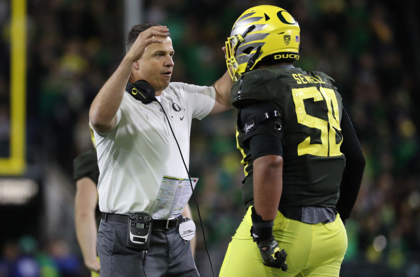 EUGENE, OREGON - OCTOBER 05: Head Coach Mario Cristobal has a moment with Penei Sewell #58 of the Oregon Ducks in the fourth quarter against the California Golden Bears during their game at Autzen Stadium on October 05, 2019 in Eugene, Oregon. (Photo by Abbie Parr/Getty Images)