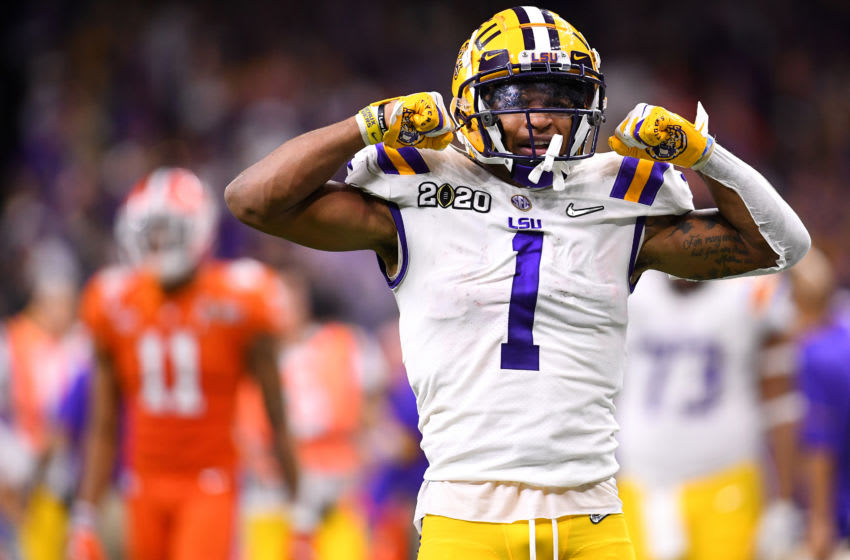 NEW ORLEANS, LA - JANUARY 13: Ja'Marr Chase #1 of the LSU Tigers celebrates a first down against the Clemson Tigers during the College Football Playoff National Championship held at the Mercedes-Benz Superdome on January 13, 2020 in New Orleans, Louisiana. (Photo by Jamie Schwaberow/Getty Images)