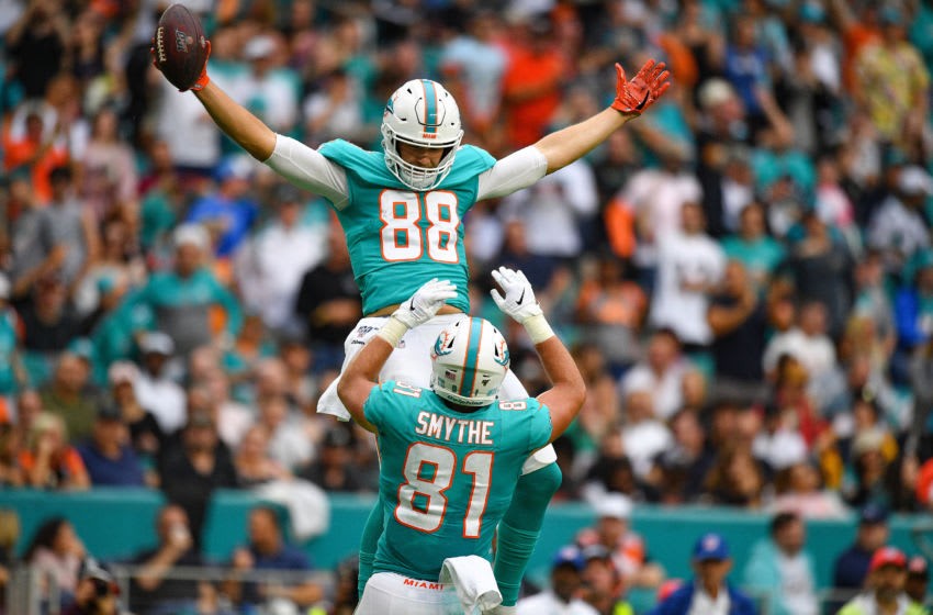 MIAMI, FLORIDA - DECEMBER 22: Mike Gesicki #88 of the Miami Dolphins celebrates catching a touchdown pass against the Cincinnati Bengals with Durham Smythe #81 in the second quarter at Hard Rock Stadium on December 22, 2019 in Miami, Florida. (Photo by Mark Brown/Getty Images)