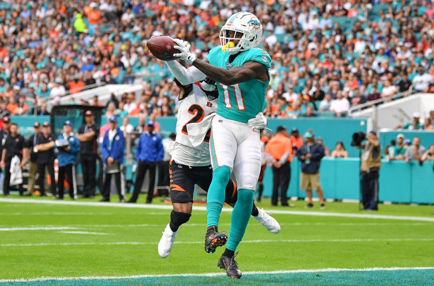 MIAMI, FLORIDA - DECEMBER 22: DeVante Parker #11 of the Miami Dolphins catches a touchndown against the Cincinnati Bengals in the first quarter at Hard Rock Stadium on December 22, 2019 in Miami, Florida. (Photo by Mark Brown/Getty Images)