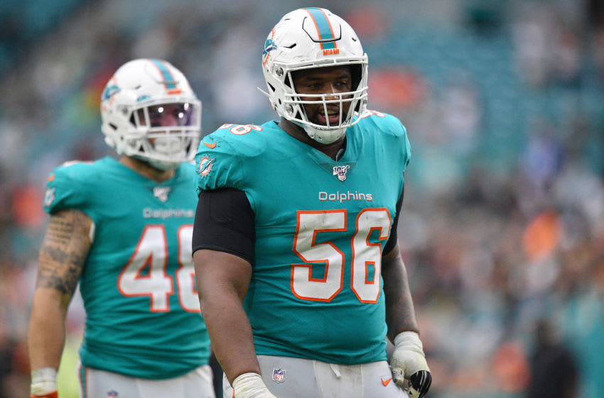 MIAMI, FLORIDA - DECEMBER 22: Davon Godchaux #56 of the Miami Dolphins lines up against the Cincinnati Bengals during overtime at Hard Rock Stadium on December 22, 2019 in Miami, Florida. (Photo by Mark Brown/Getty Images)