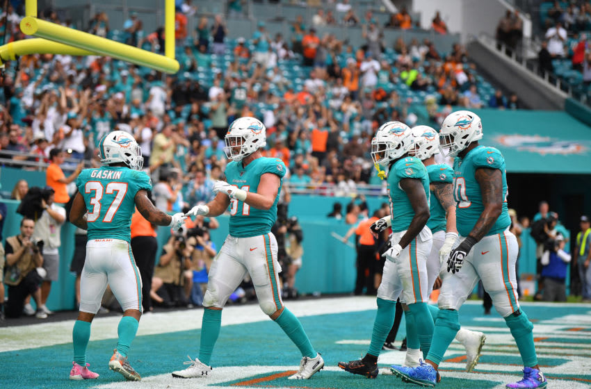 MIAMI, FLORIDA - DECEMBER 22: Miami Dolphins celebrate the touchdown by Myles Gaskin #37 of the Miami Dolphins against the Cincinnati Bengals in the fourth quarter at Hard Rock Stadium on December 22, 2019 in Miami, Florida. (Photo by Mark Brown/Getty Images)
