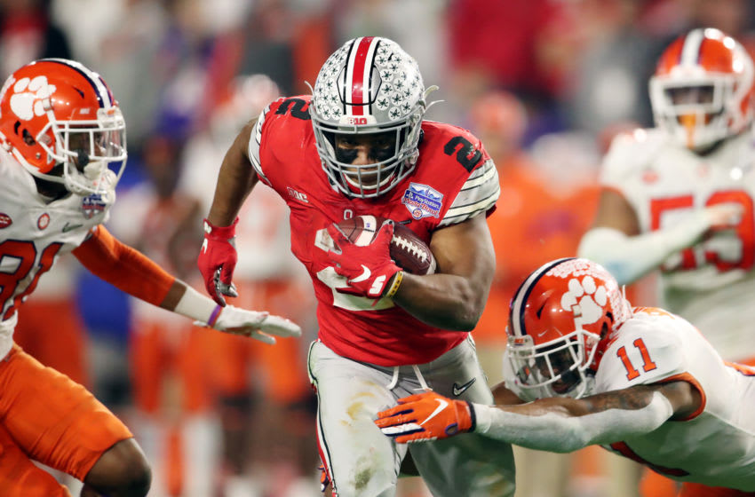 GLENDALE, ARIZONA - DECEMBER 28: J.K. Dobbins #2 of the Ohio State Buckeyes runs the ball against Isaiah Simmons #11 of the Clemson Tigers in the second half during the College Football Playoff Semifinal at the PlayStation Fiesta Bowl at State Farm Stadium on December 28, 2019 in Glendale, Arizona. (Photo by Christian Petersen/Getty Images)