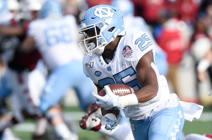 ANNAPOLIS, MD - DECEMBER 27: Javonte Williams #25 of the North Carolina Tar Heels rushes the ball against the Temple Owls in the Military Bowl Presented by Northrop Grumman at Navy-Marine Corps Memorial Stadium on December 27, 2019 in Annapolis, Maryland. (Photo by G Fiume/Getty Images)