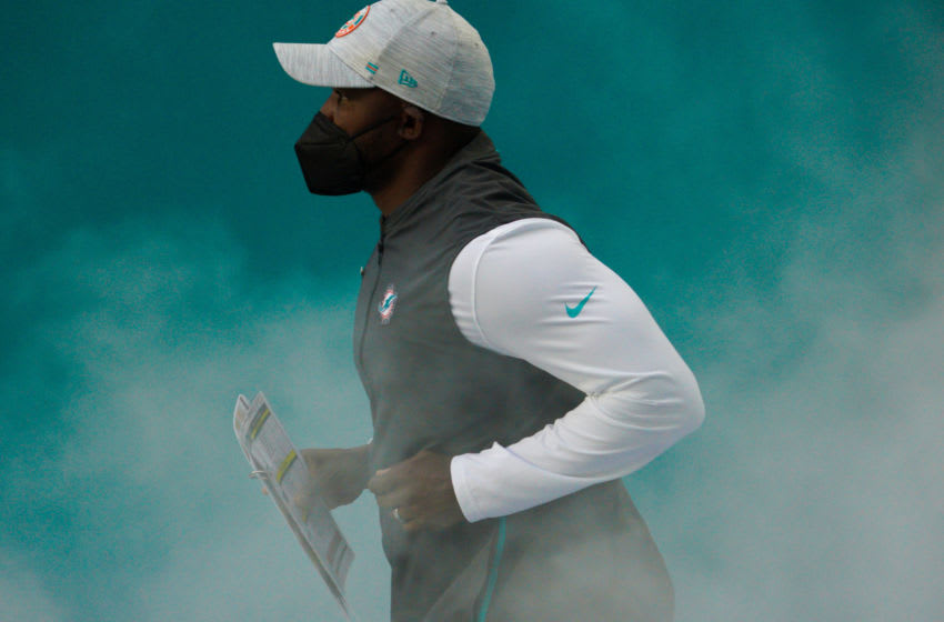 MIAMI GARDENS, FLORIDA - DECEMBER 13: Head Coach Brian Flores of the Miami Dolphins takes the field against the Kansas City Chiefs at Hard Rock Stadium on December 13, 2020 in Miami Gardens, Florida. (Photo by Mark Brown/Getty Images)