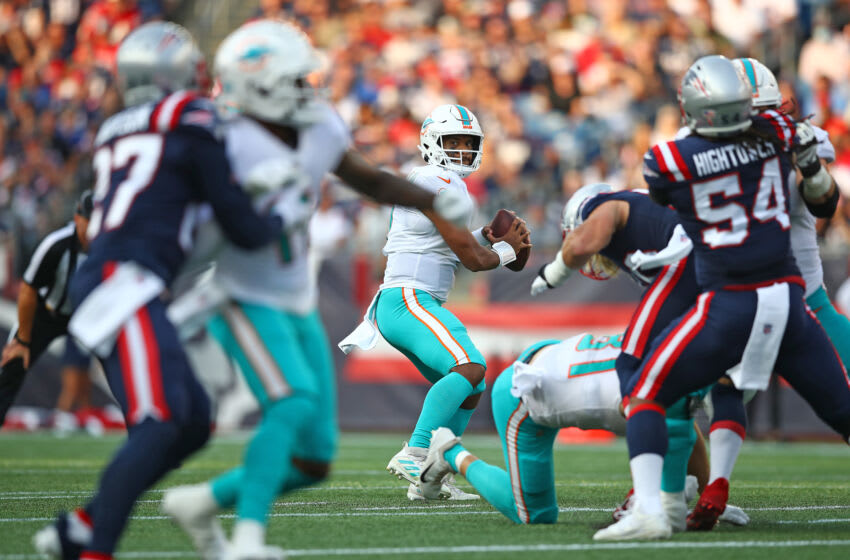 FOXBOROUGH, MASSACHUSETTS - SEPTEMBER 12: Tua Tagovailoa #1 of the Miami Dolphins looks to pass against the New England Patriots at Gillette Stadium on September 12, 2021 in Foxborough, Massachusetts. (Photo by Adam Glanzman/Getty Images)
