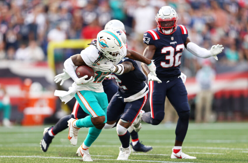 FOXBOROUGH, MASSACHUSETTS - SEPTEMBER 12: Jaylen Waddle #17 of the Miami Dolphins runs with the ball after a reception against the New England Patriots at Gillette Stadium on September 12, 2021 in Foxborough, Massachusetts. (Photo by Maddie Meyer/Getty Images)