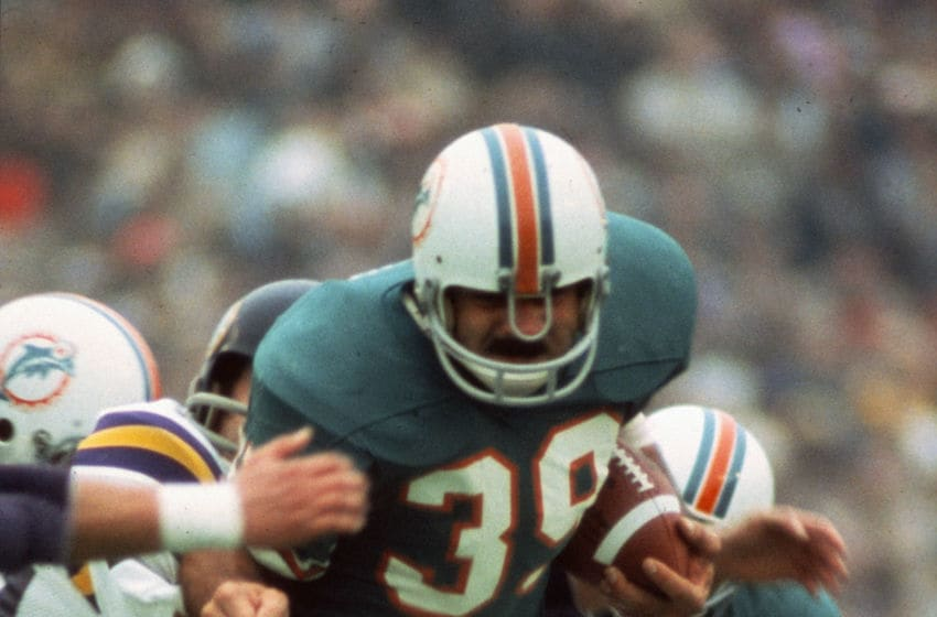 HOUSTON, TX - JANUARY 13: Larry Csonka #39 of the Miami Dolphins carries the ball against the Minnesota Vikings during Super Bowl VIII at Rice Stadium January 13, 1974 in Houston, Texas. The Dolphins won the Super Bowl 24-7. (Photo by Focus on Sport/Getty Images)