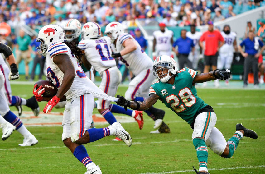MIAMI, FL - DECEMBER 02: Bobby McCain #28 of the Miami Dolphins makes the tackle on Chris Ivory #33 of the Buffalo Bills during the third quarter against the Buffalo Bills at Hard Rock Stadium on December 2, 2018 in Miami, Florida. (Photo by Mark Brown/Getty Images)