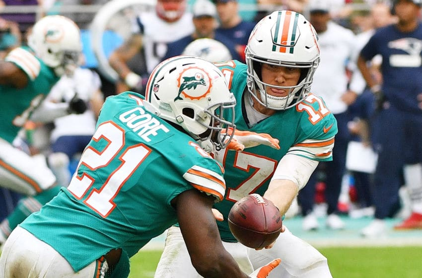 MIAMI, FL - DECEMBER 09: Ryan Tannehill #17 hands the ball off to Frank Gore #21 of the Miami Dolphins in the second half against the New England Patriots at Hard Rock Stadium on December 9, 2018 in Miami, Florida. (Photo by Mark Brown/Getty Images)