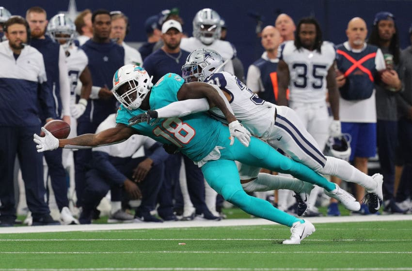 ARLINGTON, TEXAS - SEPTEMBER 22: Preston Williams #18 of the Miami Dolphins gets his pass broken up by Byron Jones #31 of the Dallas Cowboys in the first quarter at AT&T Stadium on September 22, 2019 in Arlington, Texas. (Photo by Richard Rodriguez/Getty Images)