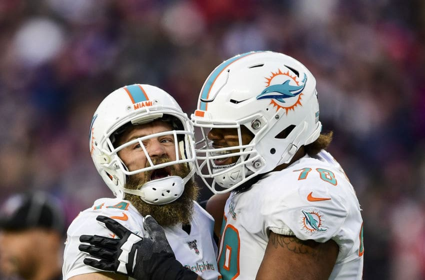 FOXBOROUGH, MA - DECEMBER 29: Ryan Fitzpatrick #14 of the Miami Dolphins reacts with Adam Pankey #78 after throwing the game winning touchdown pass during the fourth quarter of a game against the New England Patriots at Gillette Stadium on December 29, 2019 in Foxborough, Massachusetts. (Photo by Billie Weiss/Getty Images)