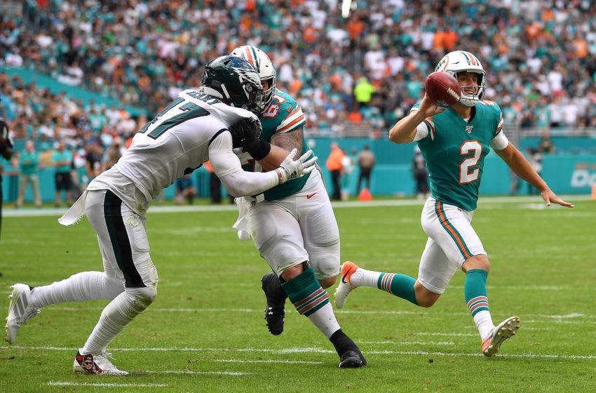 MIAMI, FLORIDA - DECEMBER 01: Matt Haack #2 of the Miami Dolphins throws a touchdown pass from a fake field goal against the Philadelphia Eagles in the second quarter at Hard Rock Stadium on December 01, 2019 in Miami, Florida. (Photo by Mark Brown/Getty Images)