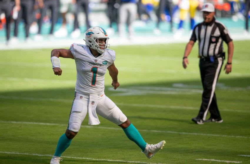 Miami Dolphins quarterback Tua Tagovailoa (1) celebrates his first touchdown pass to Miami Dolphins wide receiver DeVante Parker (11) at Hard Rock Stadium in Miami Gardens, November 1, 2020. (ALLEN EYESTONE / THE PALM BEACH POST)