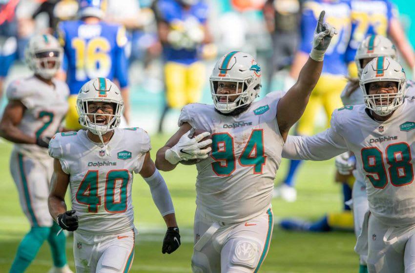 Miami Dolphins defensive back Nik Needham (40), Miami Dolphins defensive tackle Christian Wilkins (94) and Miami Dolphins defensive tackle Raekwon Davis (98) celebrate an interception against the Los Angeles Rams at Hard Rock Stadium in Miami Gardens, November 1, 2020. (ALLEN EYESTONE / THE PALM BEACH POST)
