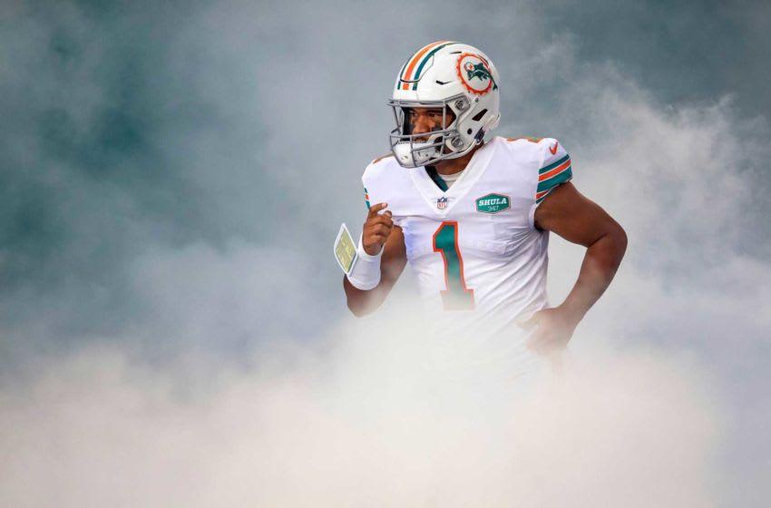 Miami Dolphins quarterback Tua Tagovailoa (1) heads onto the field at Hard Rock Stadium in Miami Gardens, November 15, 2020. (ALLEN EYESTONE / THE PALM BEACH POST)